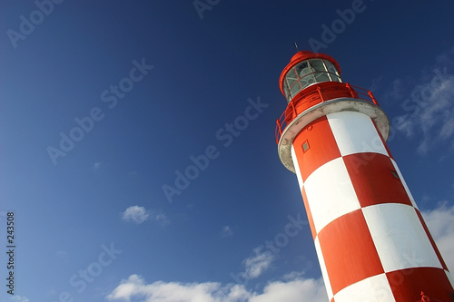 Foto op Aluminium Vuurtoren lighthouse under a deep blue sky