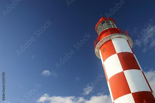 Photo Stands Lighthouse lighthouse under a deep blue sky