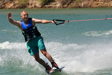 Middleage Man Wakeboarding