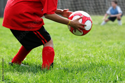 boys playing soccer Canvas Print