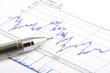 ballpoint pen on stock chart