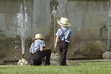 Boys Playing In Fountain