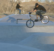 bicyclist airborne at skate park