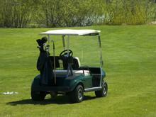 Golf Cart Sitting On Greens