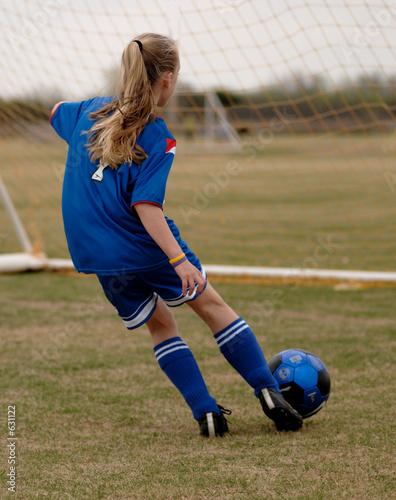 Fotografija  girl playing soccer - football