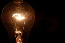 Clear Light Bulb On Black