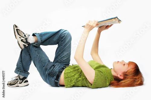 Fotografía  young girl read the book on white