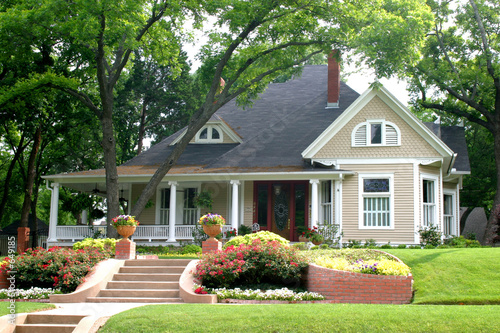 classic house with flower garden
