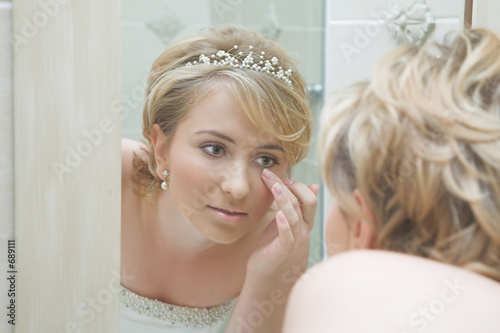 bride looking in a mirror