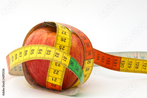 Photo  red apple with tape to measure
