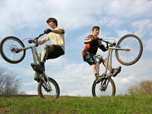 Two Mountain Bikers On Second Weels