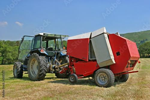 Photo circular hay baler and tractor