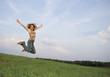 pretty girl leaping in field