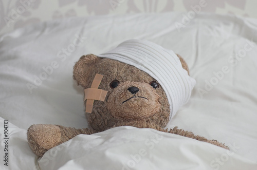 Tela teddybear in bed