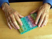 Elderly Hands With Pillbox