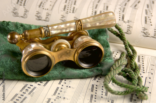 Fototapeta antique opera glasses on sheet music