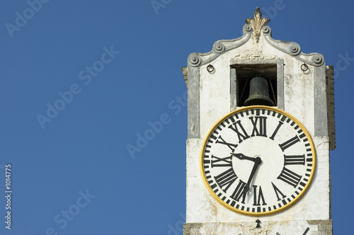 Fotografie, Obraz  ancient clock over blue sky with space for text