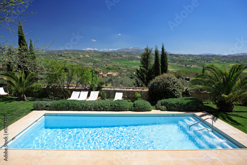Fotografie, Obraz  luxury rustic hotel and swimming pool in countryside