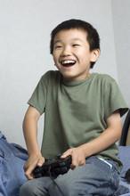 Asian Kid Playing Game