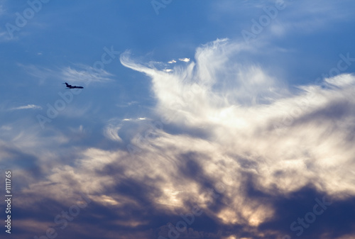 Fototapeta air-liner in evening cloudy sky obraz na płótnie