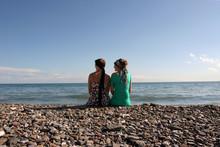 Two Girls Overlooking Ocean