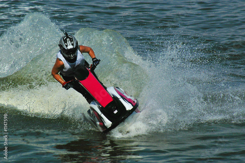 Poster Nautique motorise riding a jetski in water drops