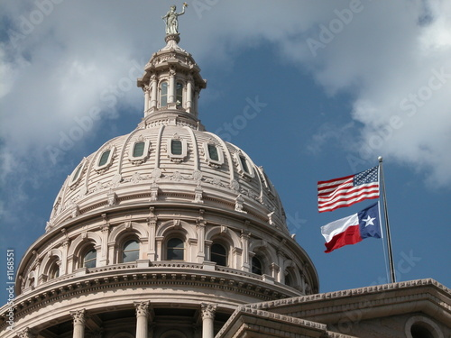 texas capitol with flags
