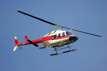 Helicopter Flying Against A Deep Blue Sky