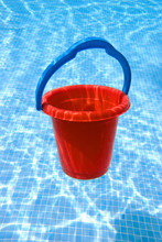Red Bucket With Blue Handle Un...
