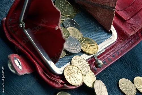 Fototapeta shabby purse with coins