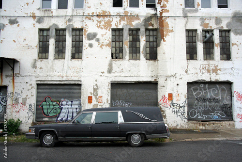 Photo  hearse and old warehouse