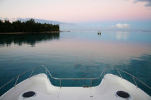 Bow Of Catamaran Boat At Sunset