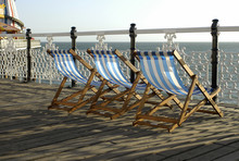 Deckchairs On Pier