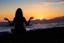 Meditating At The Beach