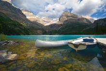 Aluminum Canoe And A Boat