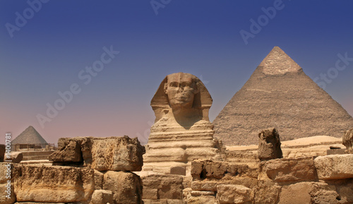 sphinx guarding a pyramid