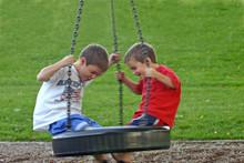 Boys On Tire Swing