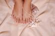 Leinwanddruck Bild feet and pearl
