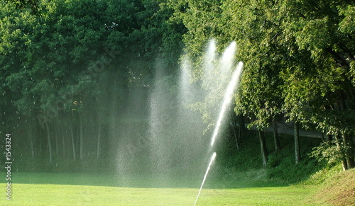 Photo sur Toile Fontaine watering machine