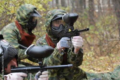 Foto op Aluminium Draken game in paintball in a forest.