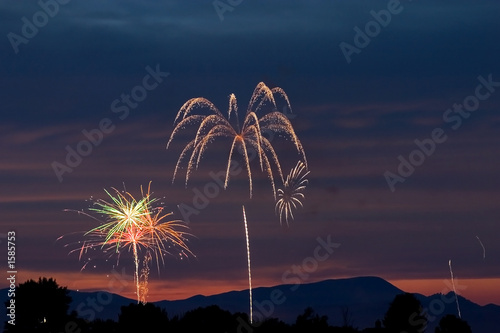 firecrackers in the sky during sunset