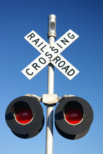 Railroad Crossing Sign With La...