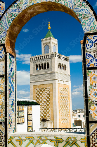 mosque tower - framed with ornamental arch in tuni
