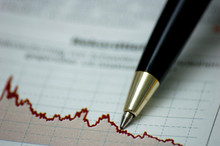 Golden Pen Showing Curves On Financial Report/mag