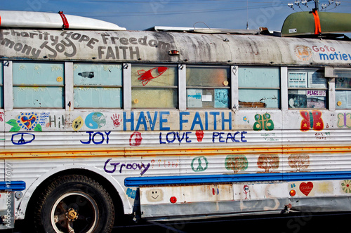 Photo old bus with hippie phrases
