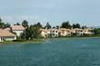 Leinwandbild Motiv single family houses by water