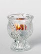 lit candle in candleholder