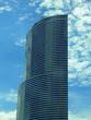 semicircular blue glass skyscraper