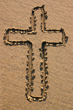 An Easter Cross Drawn In The Sand