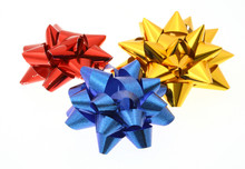 Three Colorful Bows On White B...